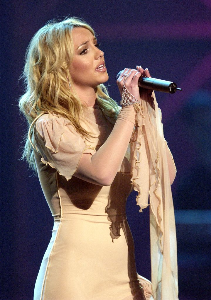"""Taking over the stage in 2002, Britney treated fans and audience members to a performance of """"I'm NotA Girl, Not Yet A Woman,"""" with clips from her movie Crossroadsplaying in the background."""