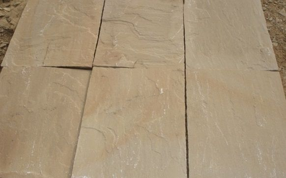 buy buff brown sandstone paving in various finishes like honed, swan cut and polished etc from Stonemart the leading natural stone supplier in india.