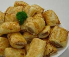 Cyndi O'Meara's Vegetarian Sausage Rolls  Ingredients :  1 onion  , peeled and halved   2 tbsp mixed herbs of choice  100 g walnuts    95 g  organic rolled oats  3 eggs    150 g fetta cheese     1 tbsp Tamari sauce  45 g  organic breadcrumbs   Rough Puff Pastry or 3 sheets Butter Puff Pastry   Sesame seeds (optional)