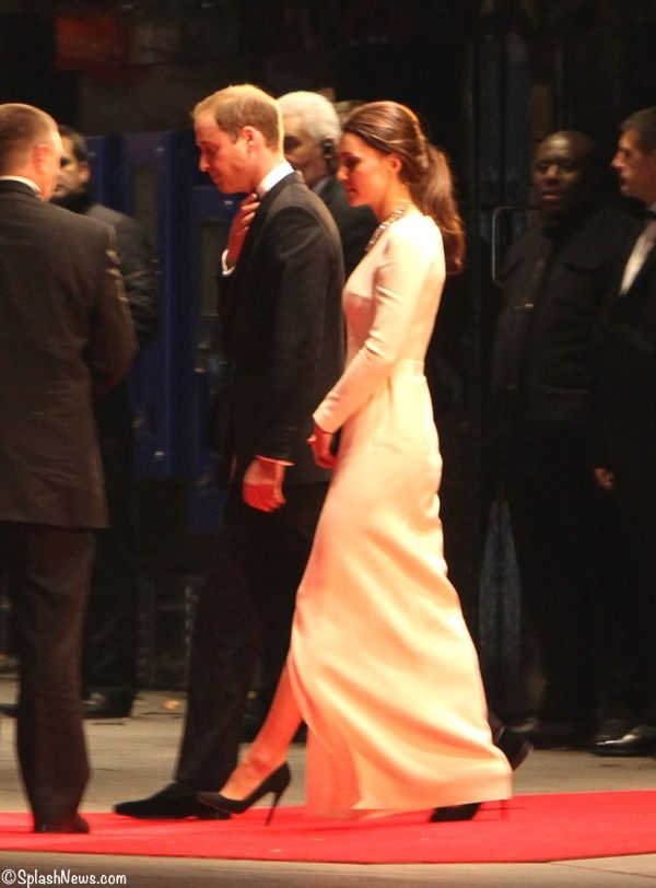 Prince William and Kate leaving the Mandela premiere after learning of his death.     Splash News