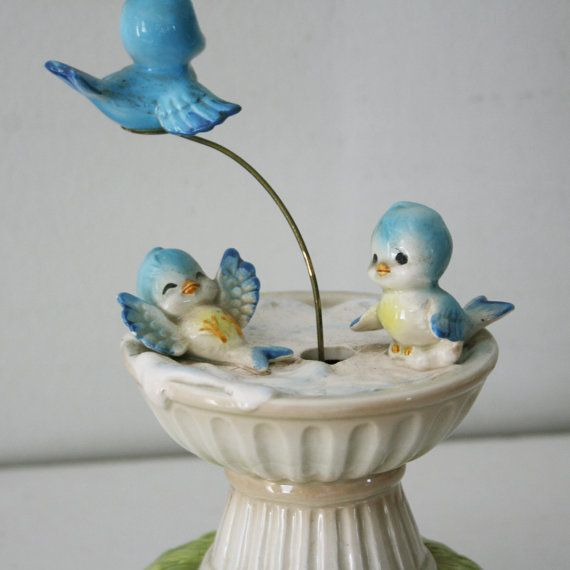 "Vintage Norcrest musical bluebirds. One ""flies"" around the bird bath, to the tune ""Born Free."""