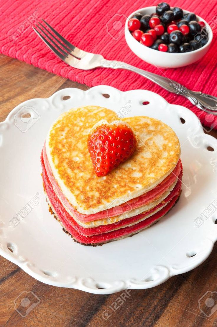 Festive Dish Valentines Day Homemade Colored Heart Shaped Pancakes With  Berries. Vibrant Indoors Vertical