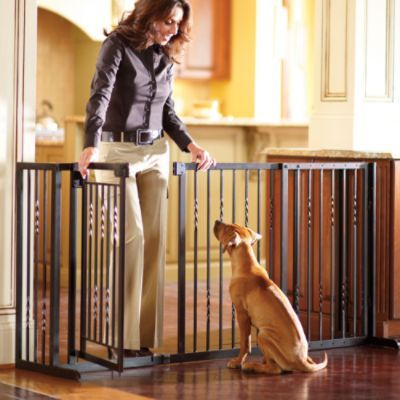 36-inch Freestanding Pet Barrier with Gate... Use this for gating off our living room.
