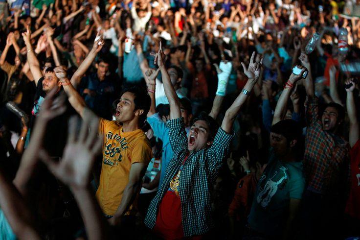 Indian cricket fans celebrate as their team wins the Cricket World Cup final against Sri Lanka, in New Delhi, India, Saturday, April 2, 2011. (AP Photo/Mustafa Quraishi)