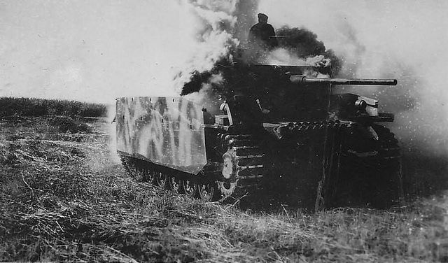Burning Panzer III Ausf M fitted with schurzen.