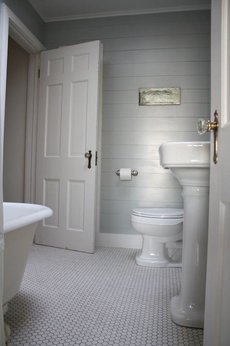 Use reclaimed wood or shiplap wall paneling to give a room for Wood panelling bathroom ideas