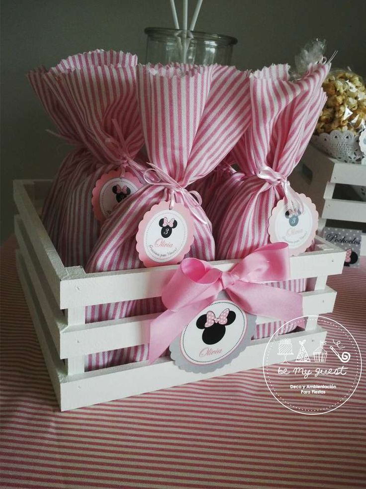Pink and white favor bags at a Minnie Mouse birthday party! See more party planning ideas at CatchMyParty.com!