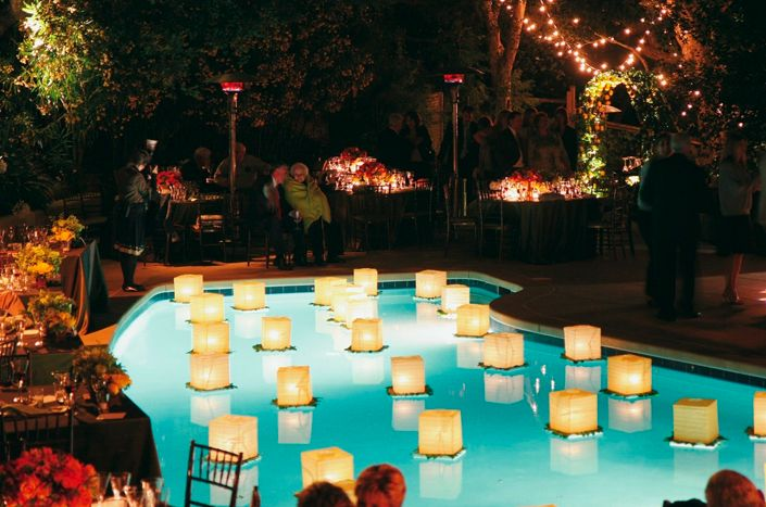 floating lotus candles for pool wedding | Set elegant floating lanterns surrounded by moss in the water, like ...