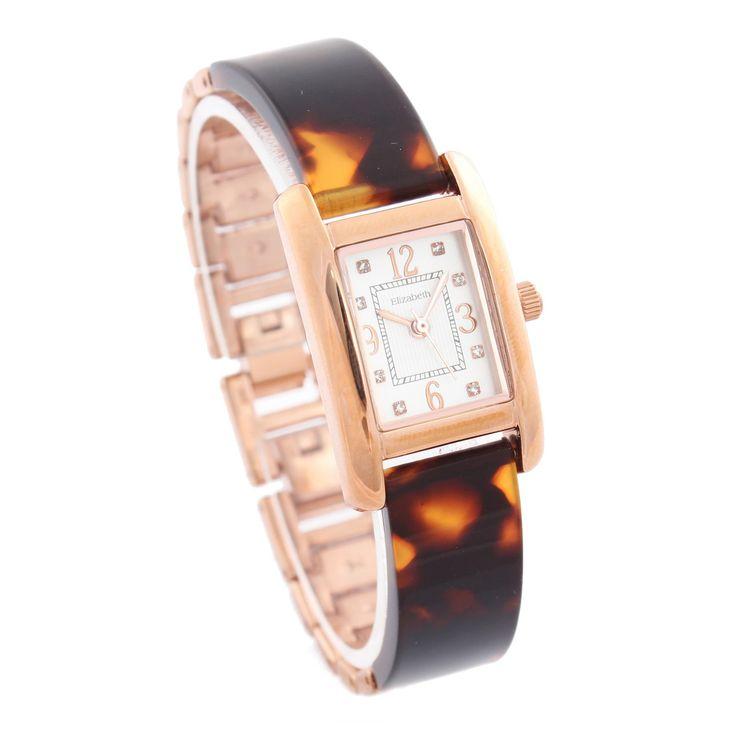 Velly Chain Watch memiliki desain unik dan mewah dari segi warna yang dapat membantu penampilan anda akan menonjol dengan mengenakan jam tangan ini.  Jam tangan Jam tangan Elizabeth Jam tangan wanita Jam tangan rantai Jam tangan unik Jam tangan kotak