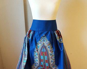 EL ÚLTIMO PC DE ESTE DISEÑO DE TELA  Hermosa africana impresión completo algodón Dashiki Maxi falda, altura de la cintura y cintura elástica en la espalda, recogiendo todo.  Tela de algodón cera impresión  Hermosa africana impresión completo algodón Maxi falda, altura de la cintura y cintura elástica en la espalda, recogiendo todo.  @ - 3,5 pulgadas de banda de la cintura  @ - 2 buen tamaño bolsillos laterales.  @ - 45 pulgadas de largo y ancho de 45 pulgadas *** por favor no dude en pedir…