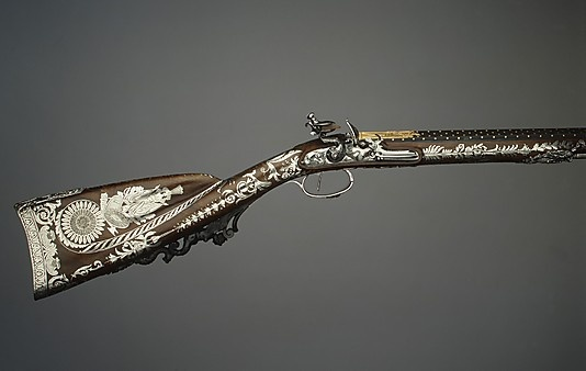 Flintlock Rifle ca. 1800. Made by Nicolas Noël Boutet. Steel, engraved, blued, and damascened with gold; walnut, carved and inlaid with engraved silver; silver, cast and chiseled; horn; mahogany;