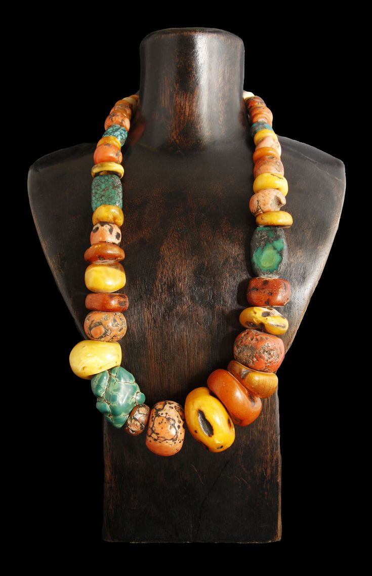 """Antique Turquoise Coral and Amber Beads Necklace. The Tibetan plateau was inhabited at least 21,000 years ago and has a long and rich history. This is depicted in this phenomenal example of their traditional jewelry. Recently restrung with a Chinese silver clasp, this amber, turquoise and coral necklace is rare and exquisite! Location: Tibet 