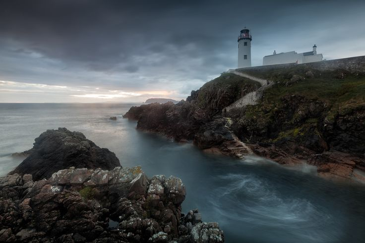 Glen Sumner Photography posted a photo:  The gathering storm closes in on the dawn light at Fanad Lighthouse.. Sounds dramatic right well really it was a Donegal summer day of changeable weather rain that would knock you down, wind that would blow you over and yet somehow I came away with a red sunburnt face.. Fanad its one of the edges of the world and it's not going to let you forget it!