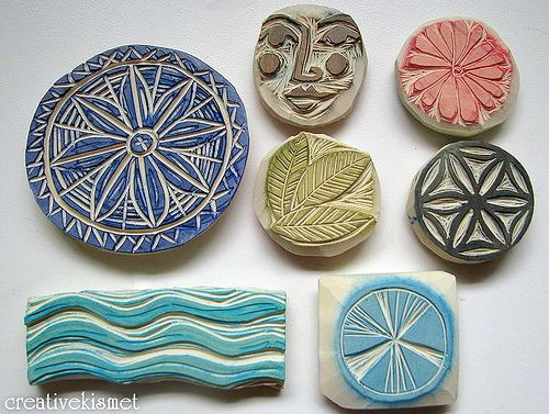 Bunches of hand carved rubber stamps with lots of texture.    Great idea for symbols.