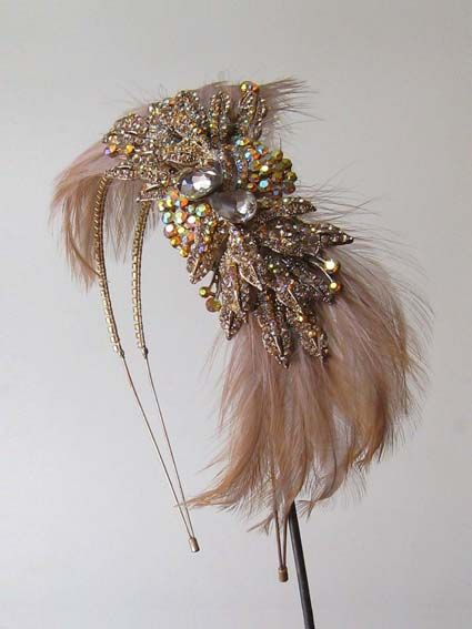 GEIGH - SWAROVSKI CRYSTAL & FEATHER HEAD PIECE, MADE WITH TOPAZ/GOLD SWAROVSKI CRYSTAL AND FAWN FEATHER IN GOLD SETTING - ON DOUBLE CRYSTAL HEAD BAND.THIS DESIGN CAN BE MADE IN OTHER COLOURS. PLEASE ENQUIRE FOR FURTHER INFORMATION. MADE TO ORDER.   Price: £490