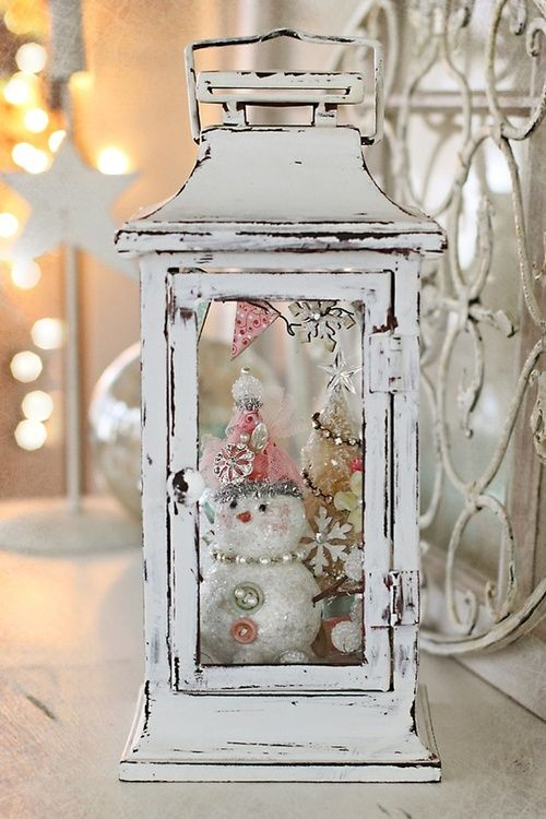 Lantern filled with Christmas decor