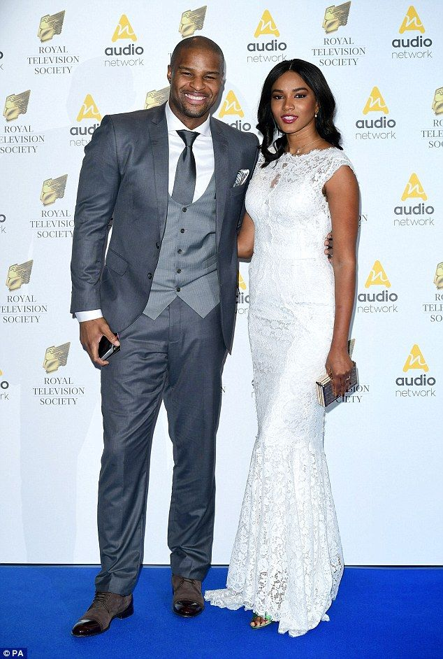 Demure: Sports presenter Osi Umenyiora and Leila Lopes looked demure in their attire