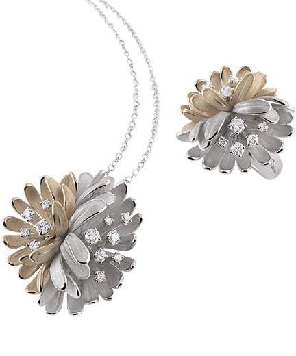 Catena in oro bianco con ciondolo a fiore con brillanti e anello coordinato