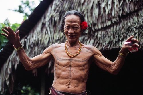 Mentawai shaman, with flower.