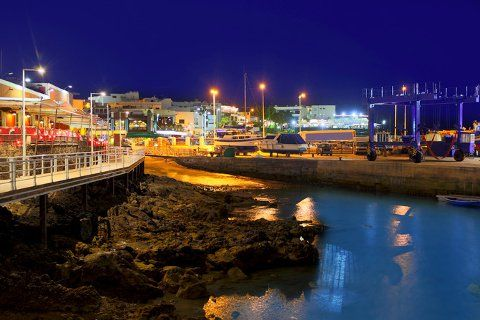 Night view of harbour in Puerto Del Carmen, Lanzarote, Canary Islands. http://www.jddiscounttravel.co.uk/destinations/europe/spain/lanzarote/puerto-del-carmen/