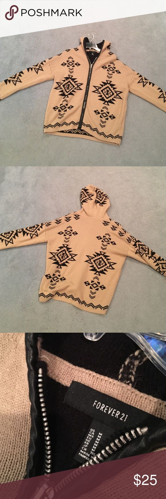 Aztec Sweater Forever 21 Aztec Zip Up Sweater: Great Condition! Super comfy, super warm tan hooded sweater with black Aztec designs. Only worn twice, Size M. I usually wear an XS/S and this fits well and has a cute baggy and comfy look: Perfect with leggings! 😊 Forever 21 Sweaters