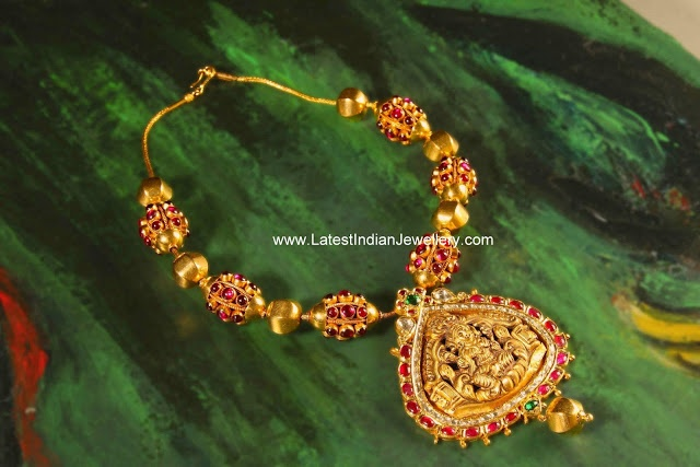 Traditional Temple Jewellery Gold Nakshi Necklace Studded with Rubies.
