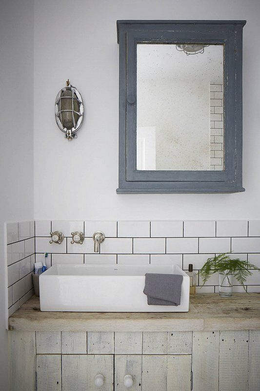 Soft dove greys and a nautical light in a bathroom vanity. Restful and beautiful! #decor #bathrooms #grey