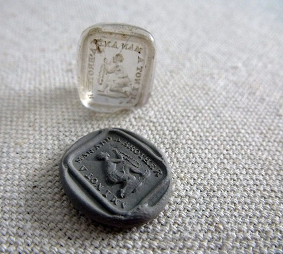 A poignant Georgian period clear glass block seal    Above the image of a slave bound in chains and kneeling in supplication.  The text around him reads:  'Am I not a man, and a brother?'    The image & text designed by Josiah Wedgwood in 1787 {Of Wedgewood Pottery fame} This famously became the banner image & text for the abolitionist or anti-slavery movement.
