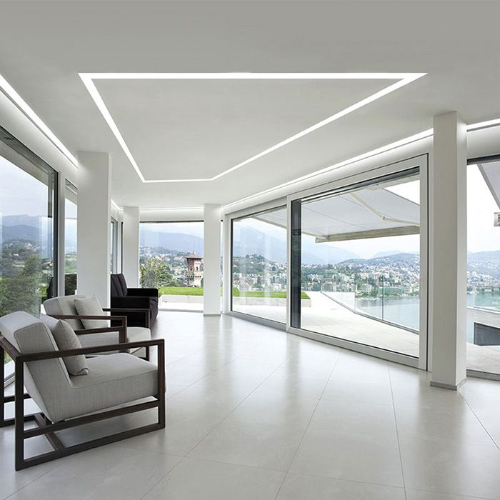 Create unique geometric shapes to flawlessly illuminate a living room or family room | Pair with white furniture and floor-to-ceiling windows for a spacious and modern vibe | TruLine 1.6A - by Pure Lighting