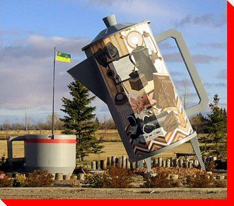 The Coffee Pot and Cup. Davidson, Saskatchewan, Canada. A 24-foot high coffee pot on the side of highway 11 was built to commemorate the towns status as the half-way-point between the cities Regina and Saskatoon. Now there is a park and picnic site there!