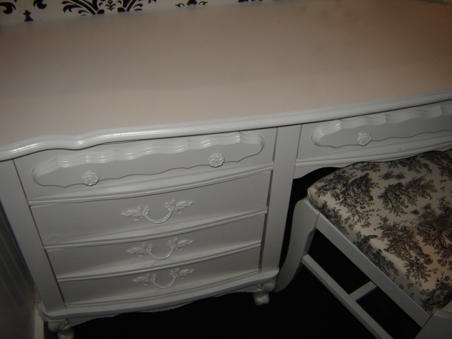 Here is a front view of the desk in my room. I wanted to show how just adding some paint can transform an old desk or dresser into something that looks very fresh.  This was one of those old 70s or 80s dressers...the white with gold brush marks on it and gold accents. I went thru so much white spray paint doing this room!  I literally sprayed everything on it, even the handles.  I store all my things I need close at hand, like scissors, glue, stamp cleaning pads,etc in these drawers.