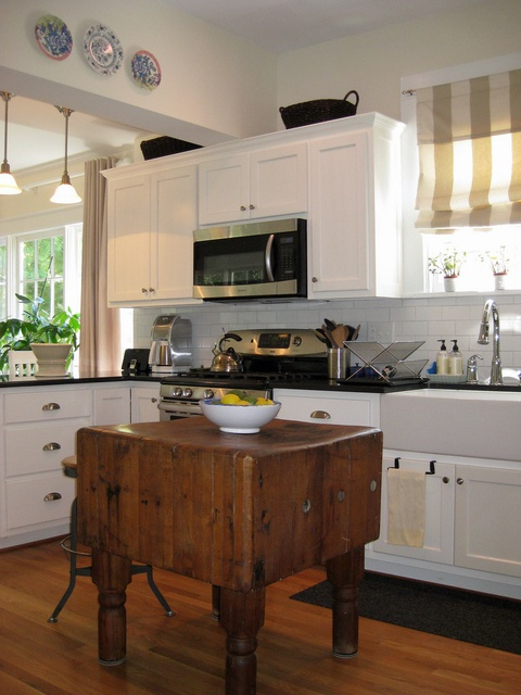 I love the farm sink and the antique counter as an island.