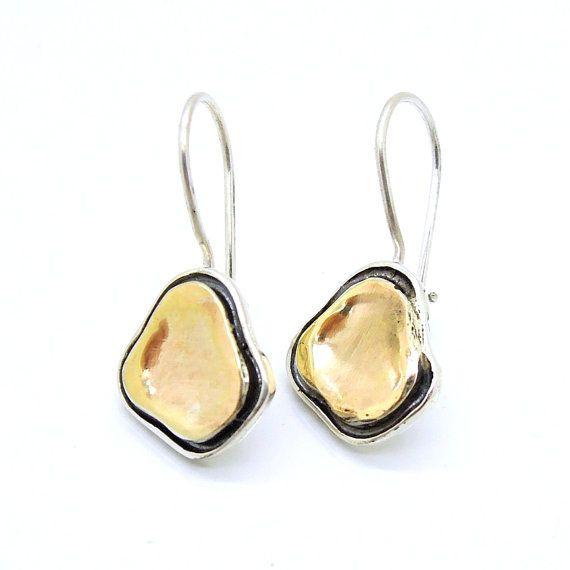 Zilveren oorbellen met geborsteld goud uniek design