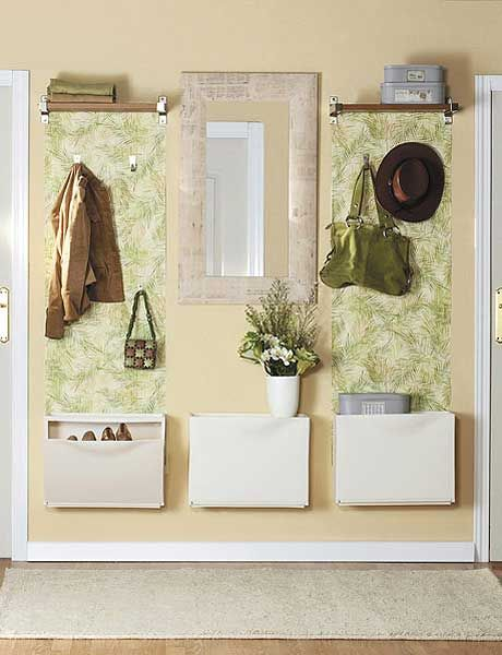 Small shelves on either side of mirror, hooks for hanging  and box style storage underneath