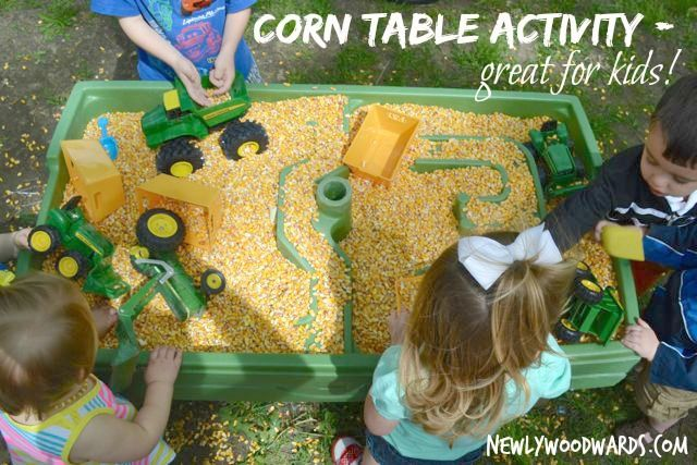 Fun activity idea for your next farm party - fill a sand table with corn and add tractors and scoops. The kids love it!