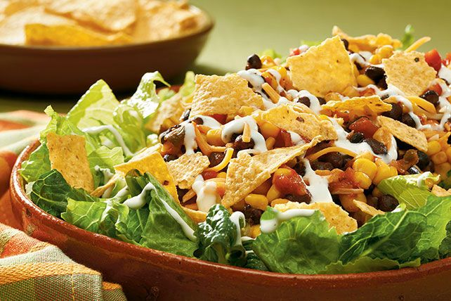 The 10-minute part is for real. Throw this together fast for a hearty taco salad with fresh greens, corn, beans and Tex-Mex layers of flavor.