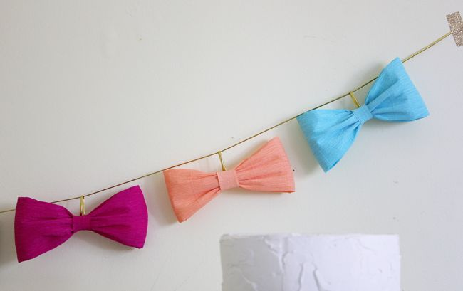 crepe paper bow garland. Could do this with a lot of other designs with paper to/also!...