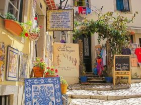 Shops with English signs, Sintra, Portugal – Most of the expat communities in Portugal are in Cascais, just west of Lisbon proper.   Cascais is a well-known retirement destination for the English people because of the connection that we have with England in the last century.
