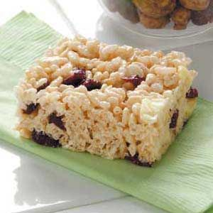 Fruity Cereal Bar - 3 tablespoons butter, 1 package (10 ounces) large marshmallows, 6 cups crisp rice cereal  1/2 cup chopped dried apple, 1/2 cup dried cranberries