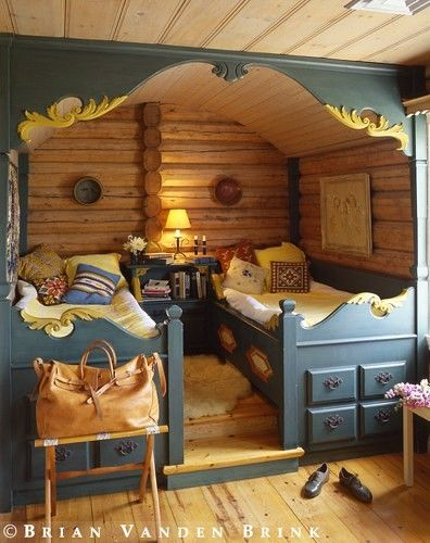 Double bed nook for cozy cabin.  Vardo!  Low ceiling appropriate. Under bed storage.  Barrel ceiling.  You know this wouldn't be that hard to make.  I wonder why he raised the floor a bit.  Just to make it more cozy and apart from the rest of the cabin?