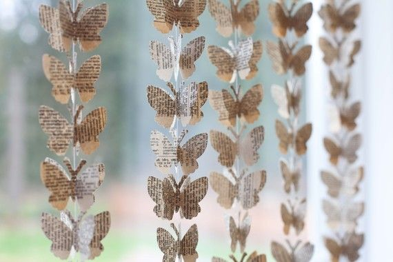 butterfly garland from book pages these would be so easy to make and so cute for a little girls room!