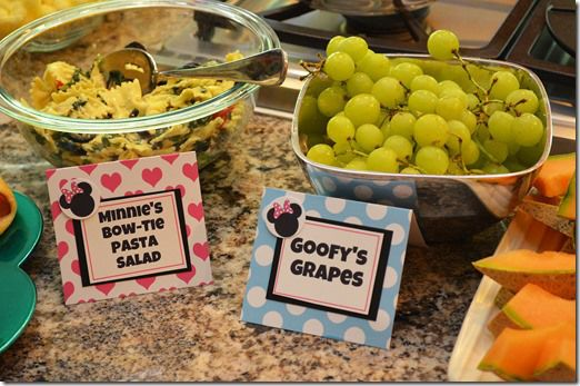 Food List: Goofy's Grapes, Clarabelle's chips & Dip, Donald's Dogs, Minnie's Bow-tie Pasta Salad, Minnie's Strawberry Le-Monade, Daisy's Garden Vegetables, Pluto's Pirate Booty, Mickey's Sweet Mallows, Pete's Oreos and Gwennie Mouse's Cookies.  Also served cheddar cheese cut out with a Mickey cookie cutter.
