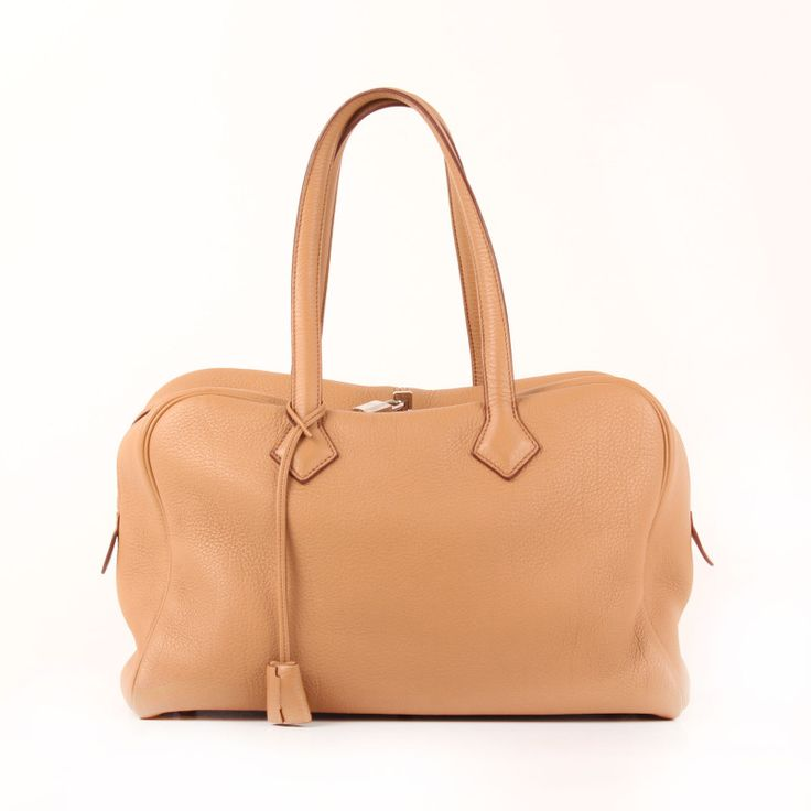 "Hermès Victoria in ""Natural"" Brown Clémence Leather."