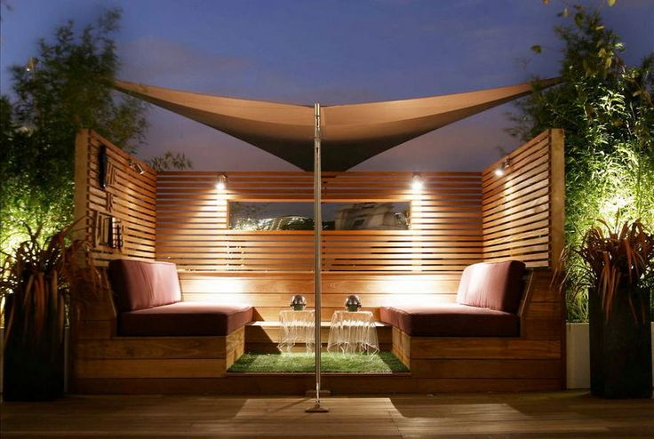 Another patio designing is done here in the image. This place is decorated with various LED lights, a stylish shade over the raised wooden deck, where the delightful construction of the built-in sofas is also made to provide you something exceptional for your seating.
