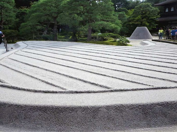 This Zen garden at Ginkakuji Temple in Kyoto, Japan, represents waves and a miniature Mount Fuji.