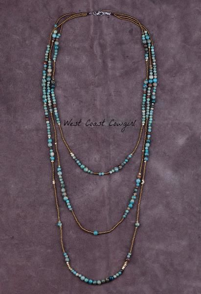 A statement necklace just for you with three layered bead strands.  So many hues of turquoise jasper natural stone beads combined with tiny gold and brass colored beadlets in this necklace to keep it interesting and versatile.  Layer lengths are approximately 22, 28, and 34 inches