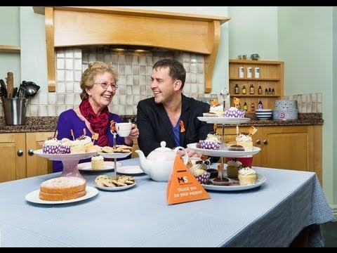 Scott Mills tells us why he's supporting Cake Break this year... while his mum Sandra can't resist trying some cake (it's understandable).