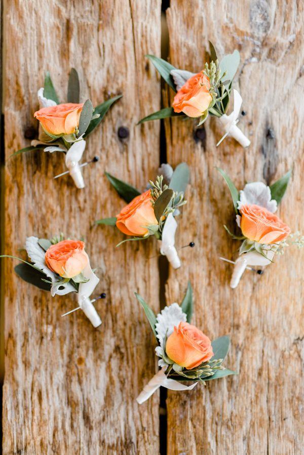 orange boutonnieres - photo by Caroline Lima Photography http://ruffledblog.com/blue-and-peach-organic-wedding