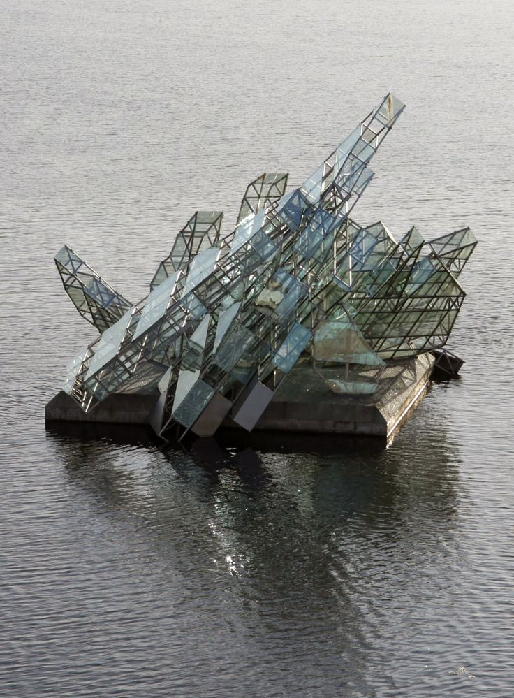 """Monica Bonvicini - She Lies (2010)  """"A permanent installation floating in the fjord by the Oslo Opera House in Norway. 39 feet above the water surface, the sculpture turns on its axis on a concrete platform with the tide and wind."""""""
