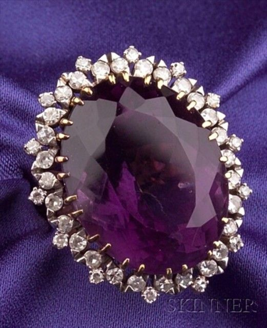 18kt Gold, Amethyst, and Diamond Ring, prong-set with a large oval-cut amethyst measuring approx. 25.35 x 19.89 x 13.92 mm, framed by forty-two single-cut diamond melee, approx. total diamond wt. 1.00 cts., size 7 3/4.  Estimate $800-1,200.